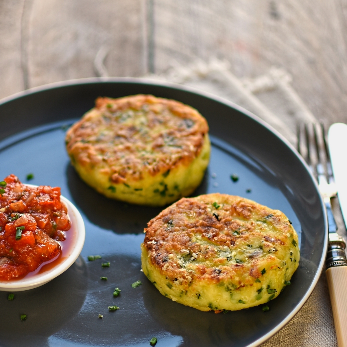 leek, potato and chive cakes with shallot and tomato sauce