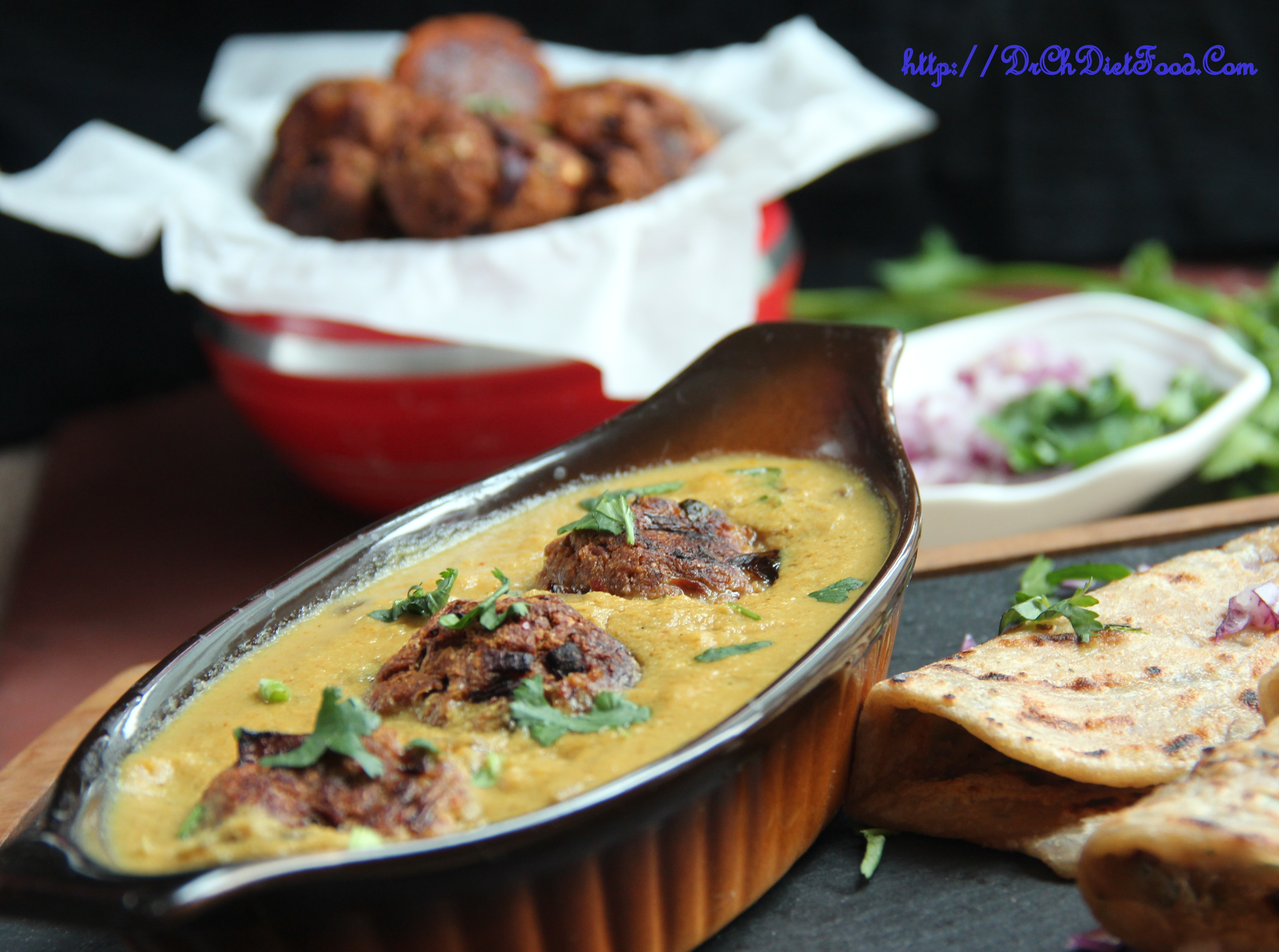 Baked Bread kofta in dudi gravy (Cream free)