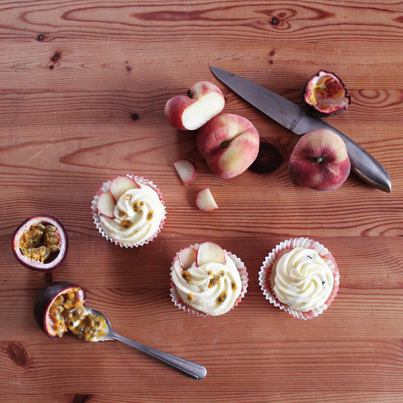 Saturn peach fairy cakes with passion fruit buttercream