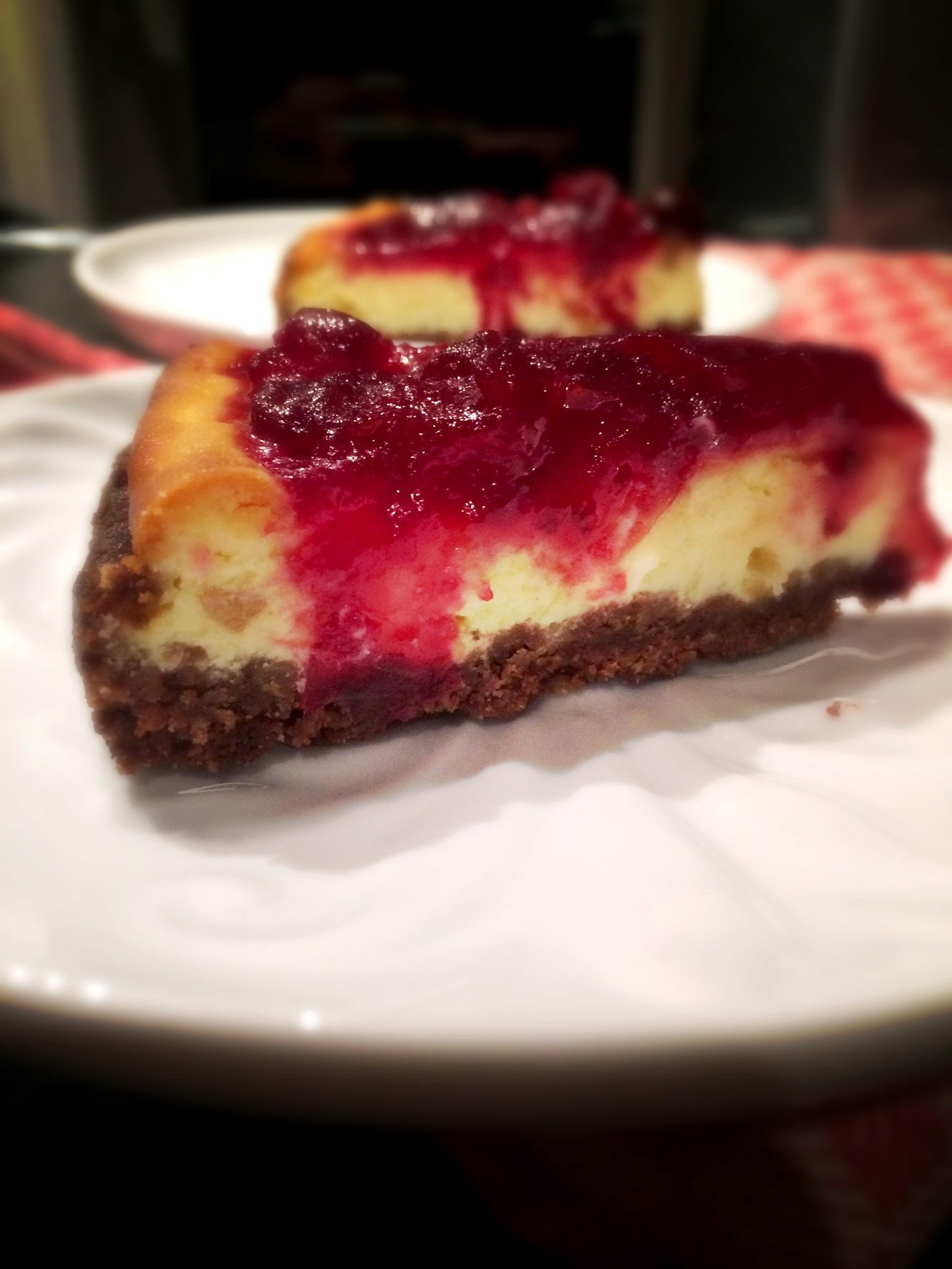 Witte chocolade gember cheesecake met cranberry gember topping
