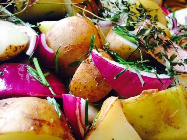 Roast New Potatoes With Red Onion , Thyme And Chives