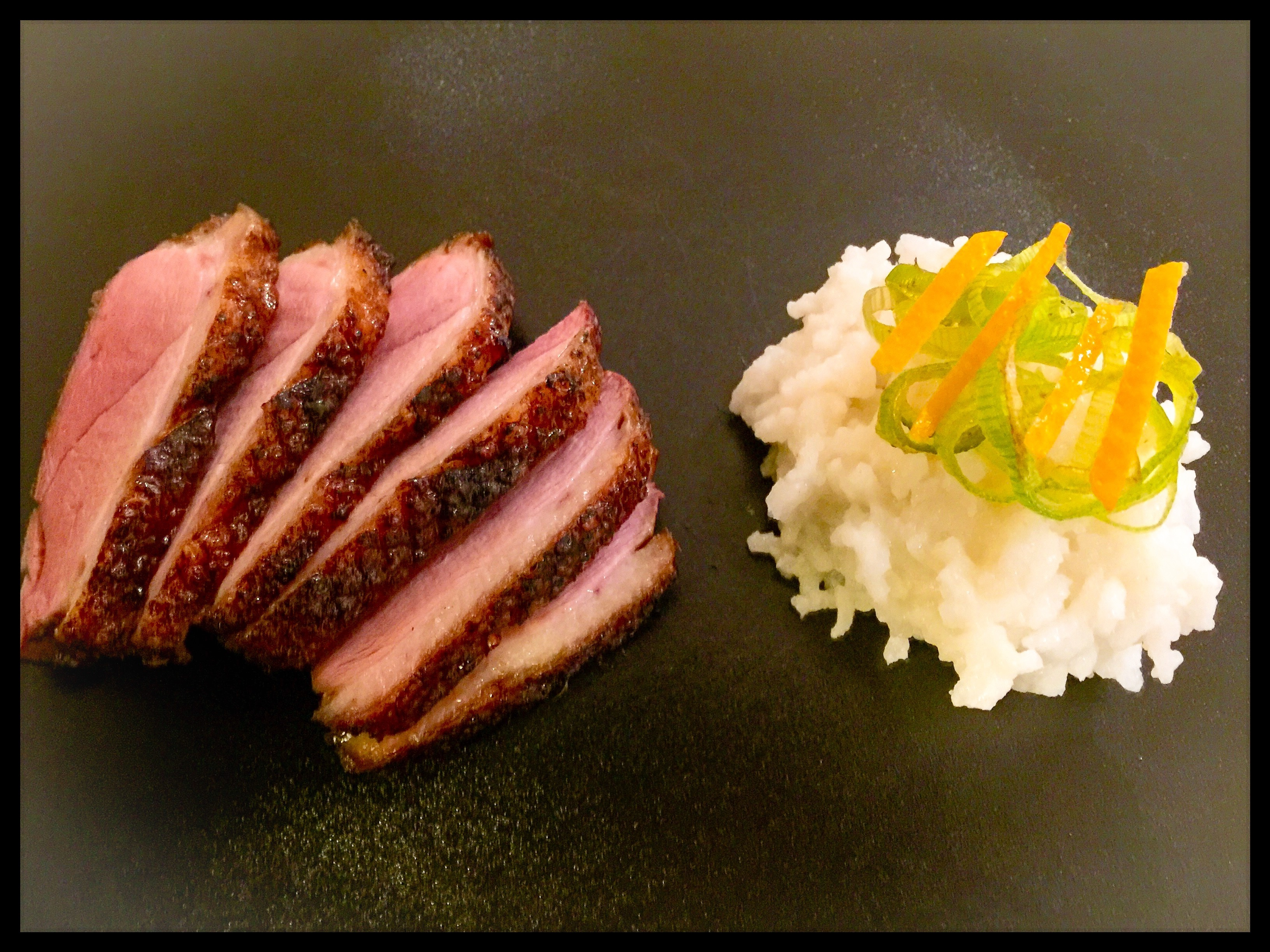 Tea smoked duck with orange rind rice