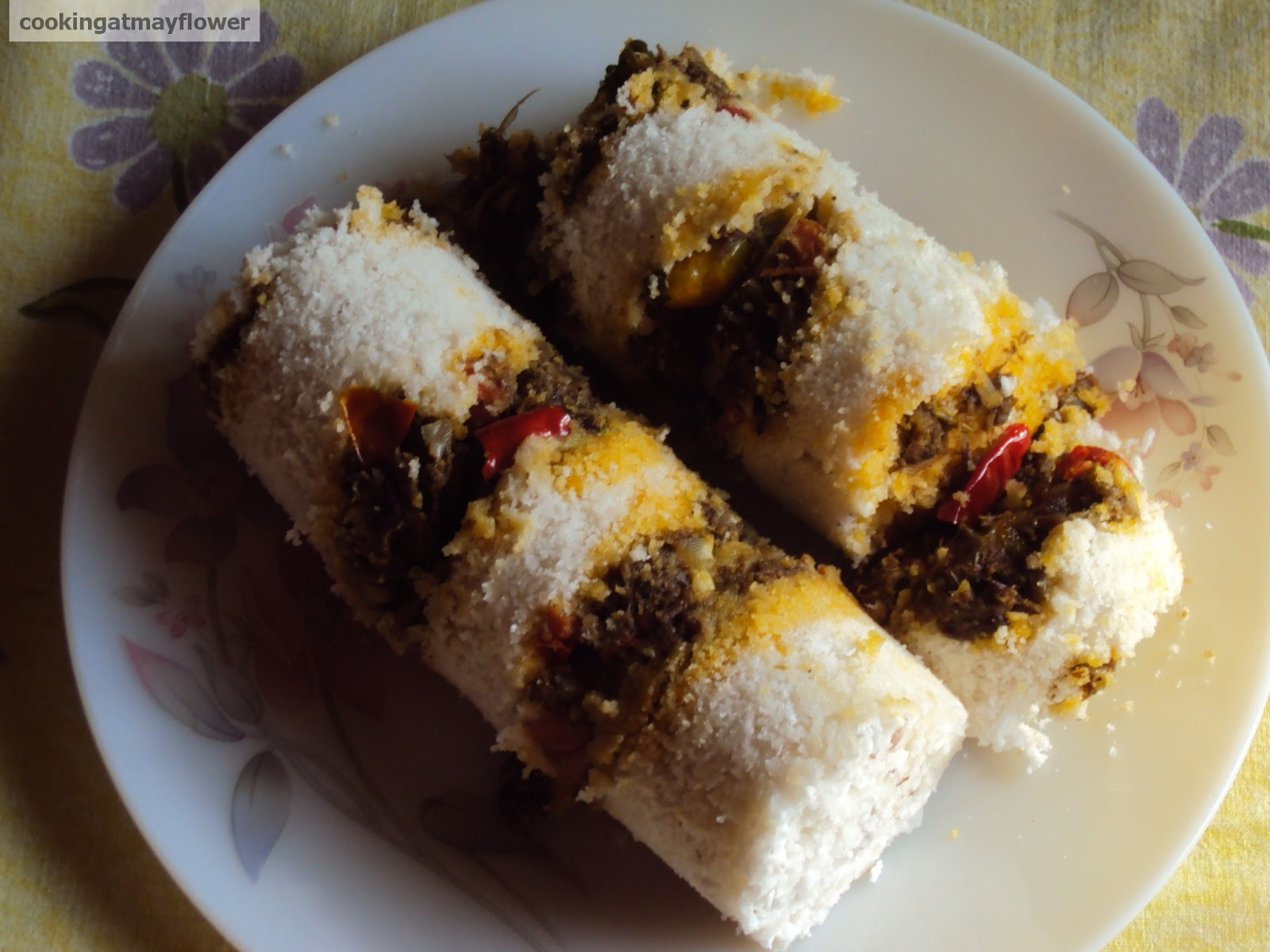 Erachi puttu / Steamed rice flour cake layered with spicy meat mixture.