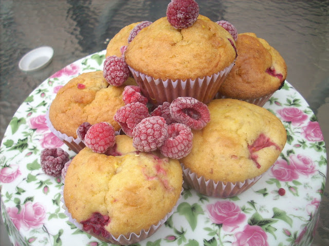 Raspberry Cupcakes with  orange sugar drizzle