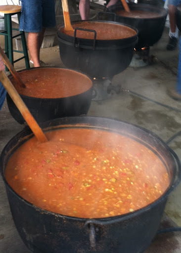 Stirring the Pot – Stew Masters blend the ingredients in seasoned black kettles until the Brunswick Stew is just right!
