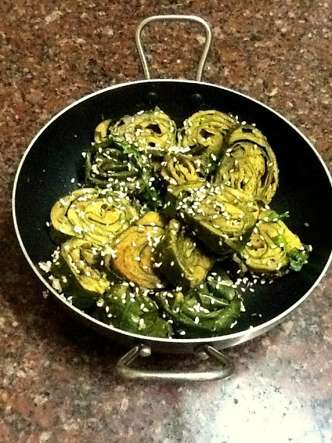 Patra ( Spicy steamed  Taro leaf rolls or spirals)