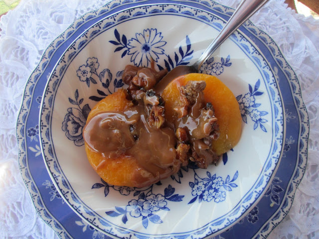 Roasted peaches with nuts and  dulce de leche