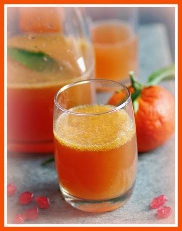Coquetel de champagne com tangerina e romã