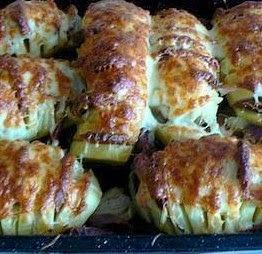 Papas al horno con panceta y cebollas