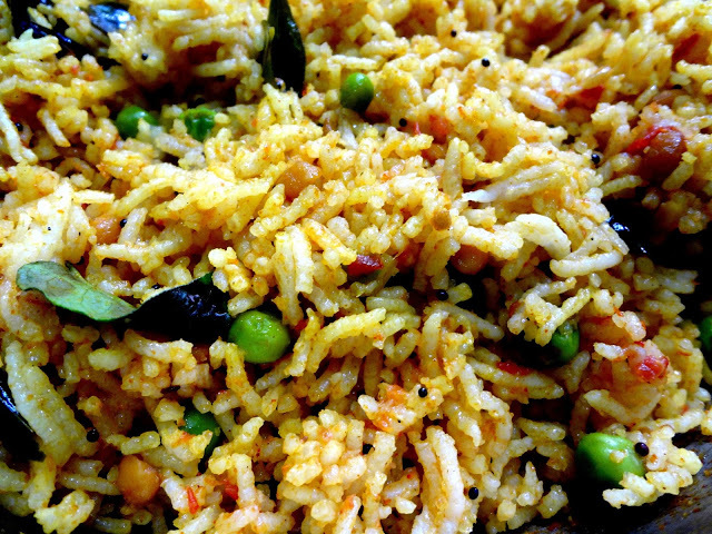 Tomato Rice with spring onions and green peas.