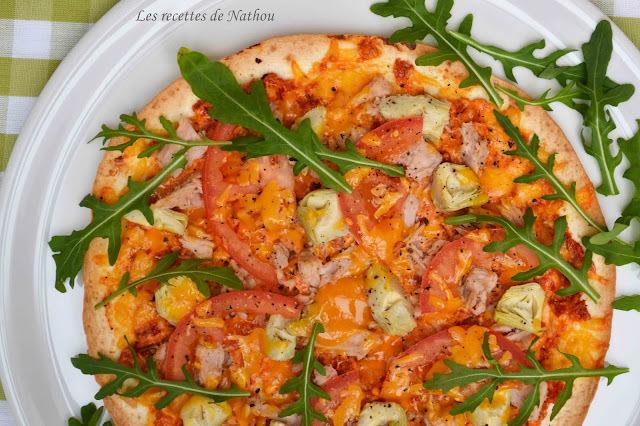 Pizza-wrap au thon, coeurs d'artichauts, pesto de tomates séchées à la ricotta... etc...