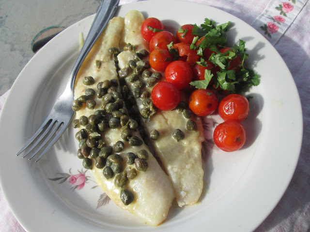 Fish with capers sauce and cherry tomatoes
