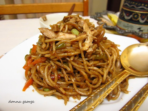 In the Kitchen with a Plate of Spicy Singapore Chicken Noodles