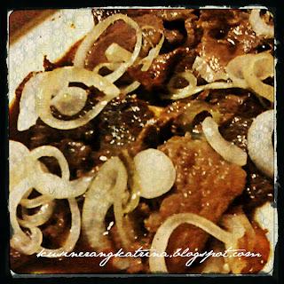 A Combination of Pork Steak and Bistek Tagalog