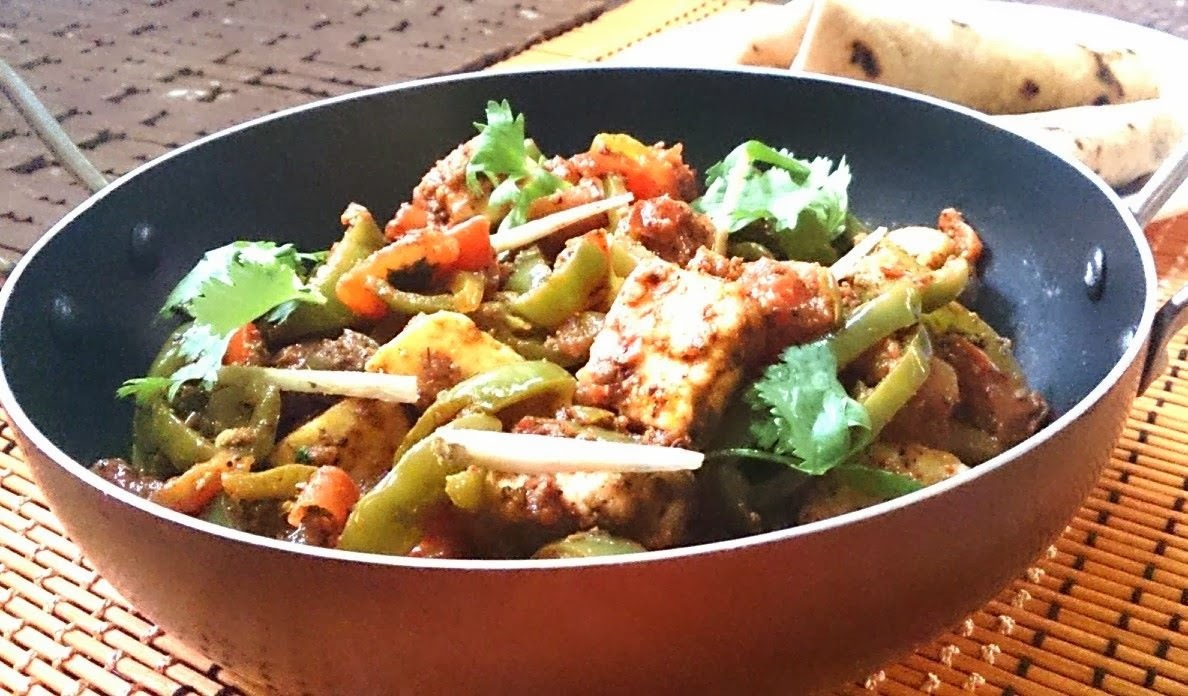 Kadai Paneer ...... A tasty , irresistible dish using soft cubed cottage cheese, bell pepers and Indian spices .