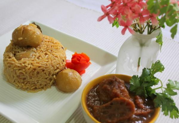 Mehun wara Chawaran (Tinda Rice) au Bhe' Patata Gesh mei (Lotus Stem Curry)