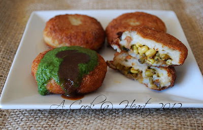 Aloo Tikki Chaat  (Stuffed Potato Shells)