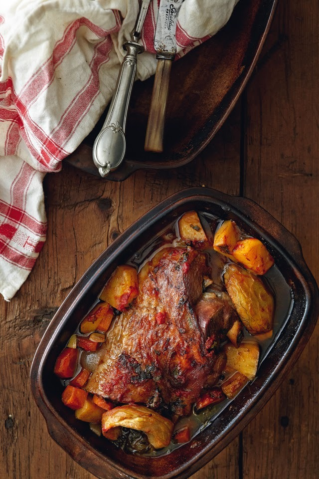 Slowly baked lamb with carrots, potatoes and artichokes in red wine sauce