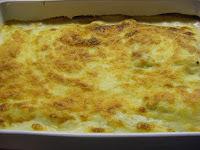 Gratinerede cannelloni med fyld af kødsauce