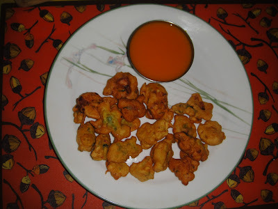 CHITTI BAJJILU -MANGO RASAM(deep fried chikpea flour fritters served with sweet mango puree
