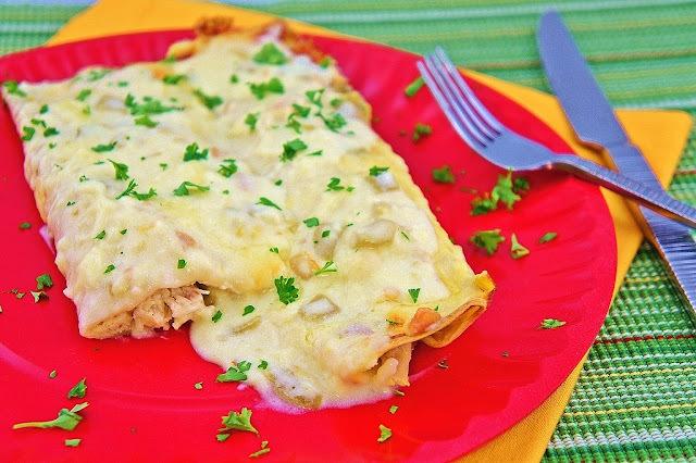 White Chicken Enchiladas with Green Chili Sour Cream Sauce