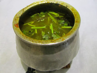 Eeya Shombu rasam / Rasam in lead pot.