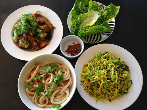 Sag Aloo and Keralan Cabbage with Spiced Squid and Garlic Chilli Sauce