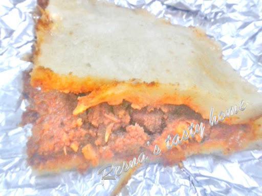 Meen pathiri (Fish stuffed steamed rice rotti)