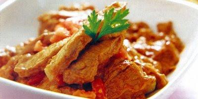 Tacos de cerdo en mole de cacahuate