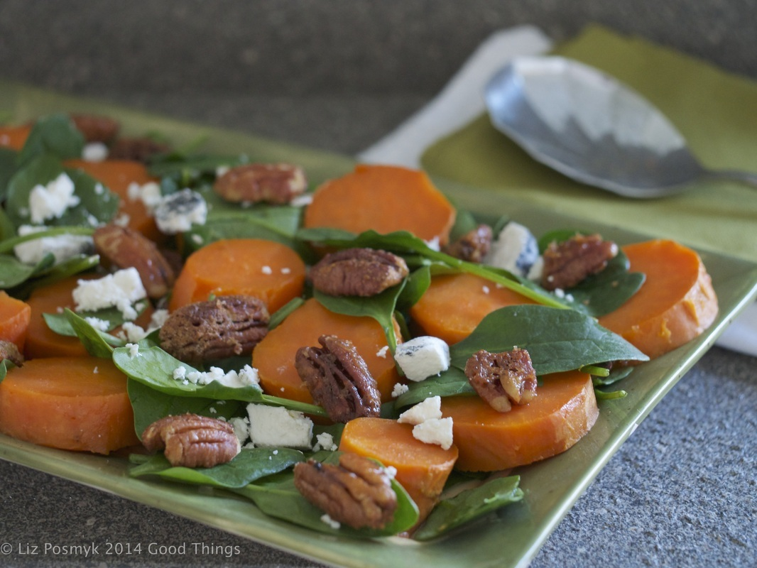 Baked sweet potato with ashed goat cheese, baby spinach and maple coconut pecans