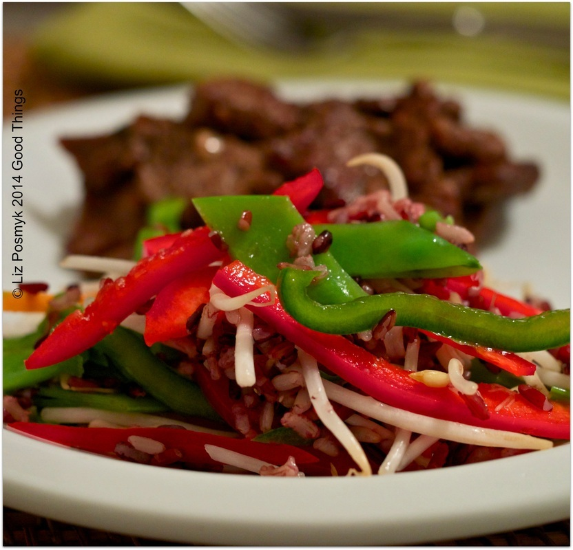 Shaking beef (Bo luc lac) with wild rice, snow pea and bell pepper salad