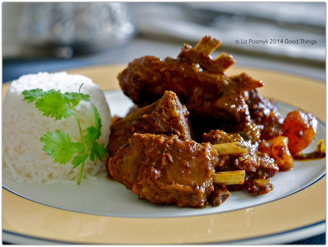 Slow-cooked goat curry with basmati rice