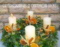Advent Wreath decorated with dried oranges and cinnamon sticks