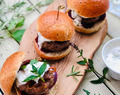 Homemade burgers with mint and cumin yogurt sauce