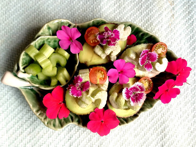 Avocado and celery cocktails with vegan mayo and edible flowers