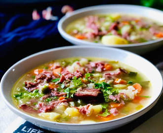 Potato soup with ham hock and petit pois (garden peas)
