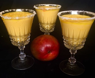 Mango Lassi served Margarita style with sugar on the rim .