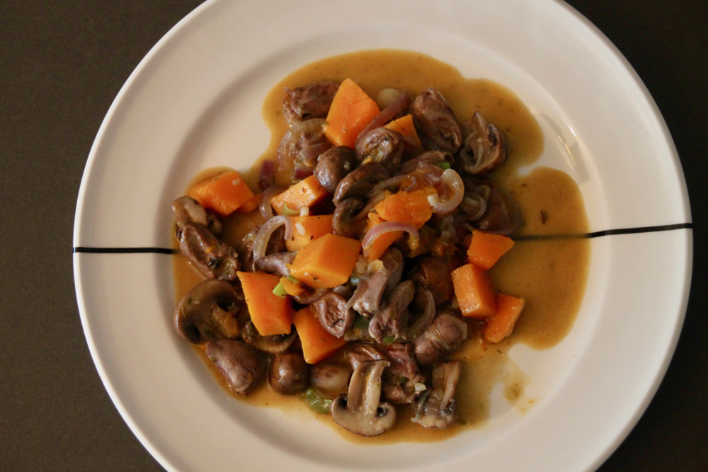 Stew of chicken hearts with pumpkin and mushroom