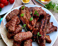 Homemade mici – romanian garlicky meat open sausages