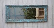 Spegel med vacker träram