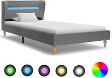 vidaXL Sängram med LED ljusgrå tyg 90x200 cm