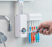 Tandpastadispenser med tandbørsteholder