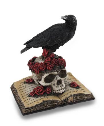 Perched ravn på Rose Skull og åpner poesi bok statuen
