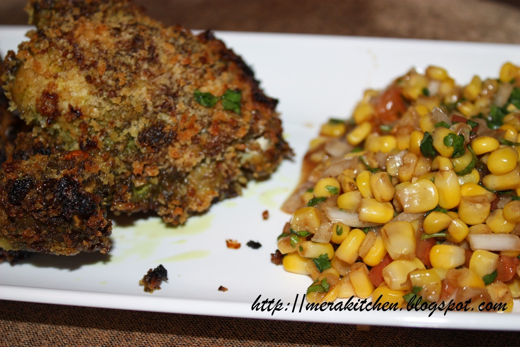 Oven fried herbed chicken with corn salsa/chaat