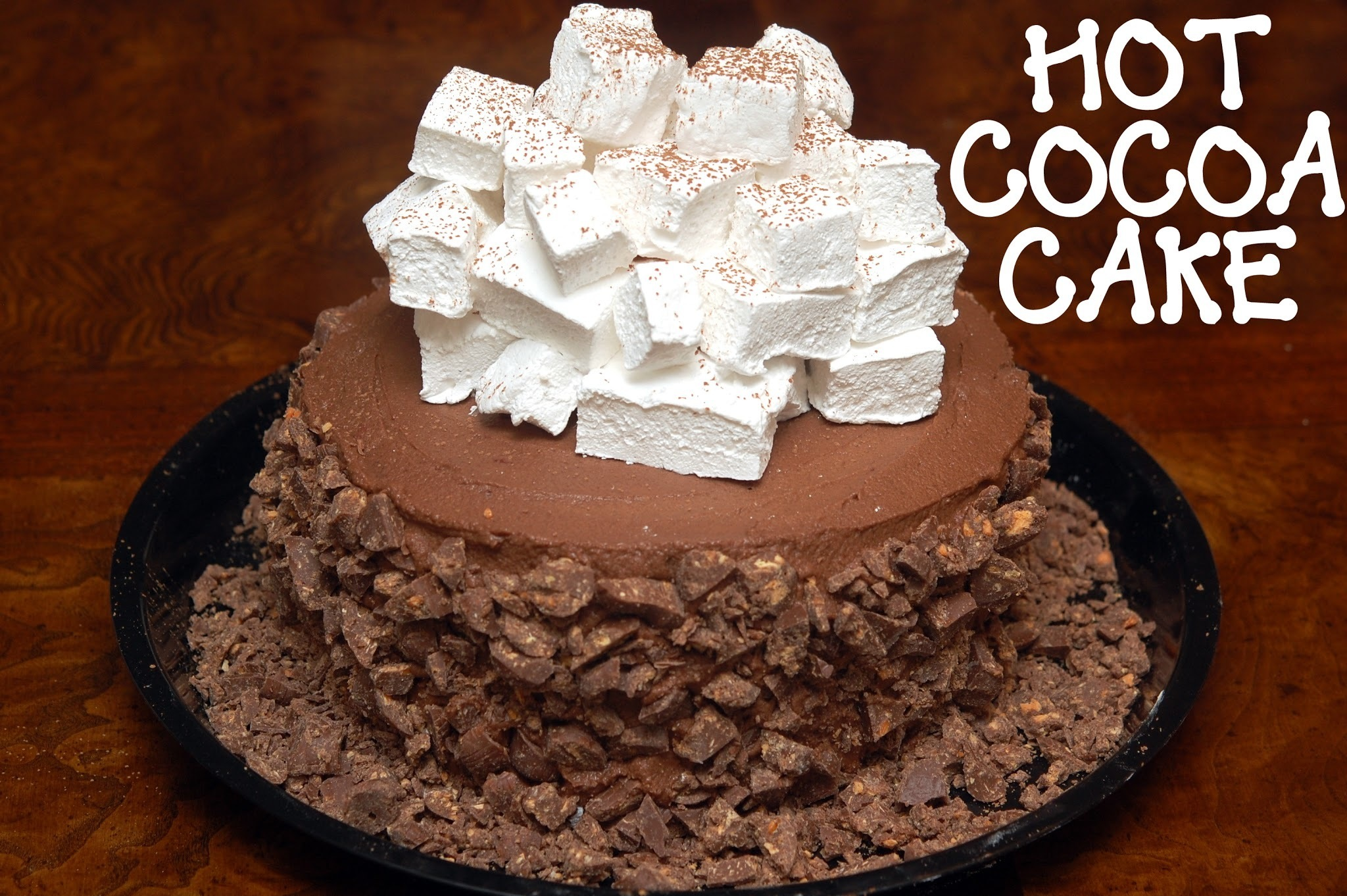 FLOURLESS, TRIPLE LAYER, HOT CHOCOLATE CAKE WITH HOMEMADE MARSHMALLOWS & CRUSHED BUTTERFINGERS
