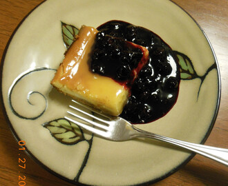 Lemon Cheesecake with Lemon Curd and Blueberry Sauce