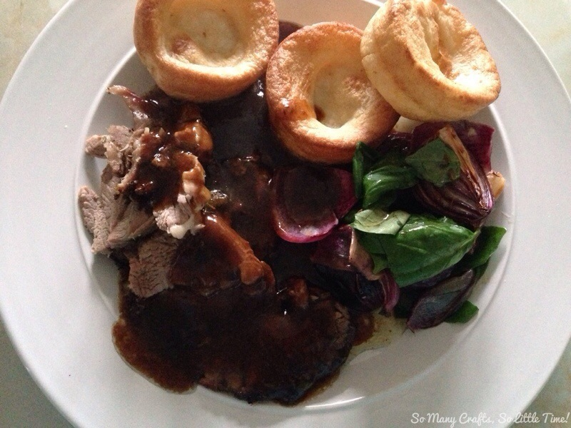 Roast shoulder of lamb with herbs and honey served with roast red onions and basil