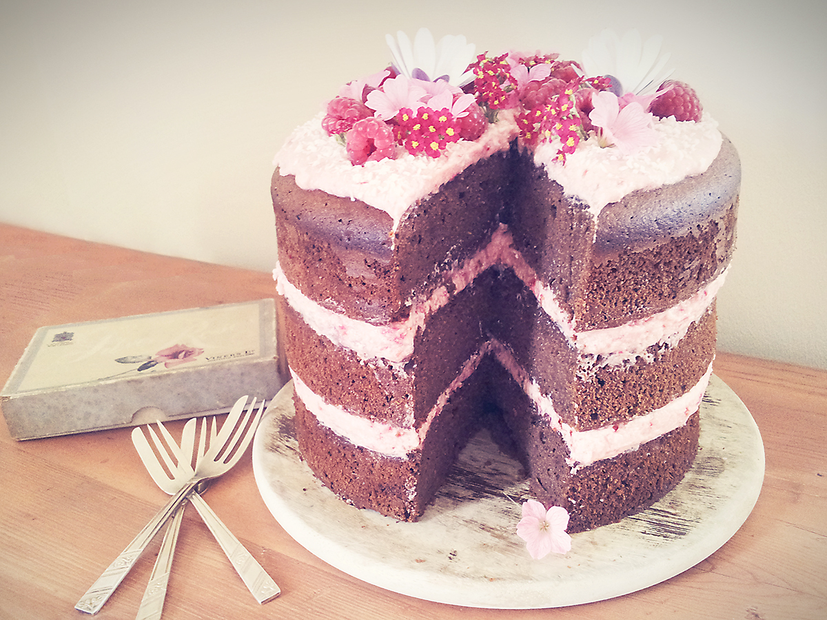 Gluten free chocolate cake with toasted coconut and raspberry buttercream