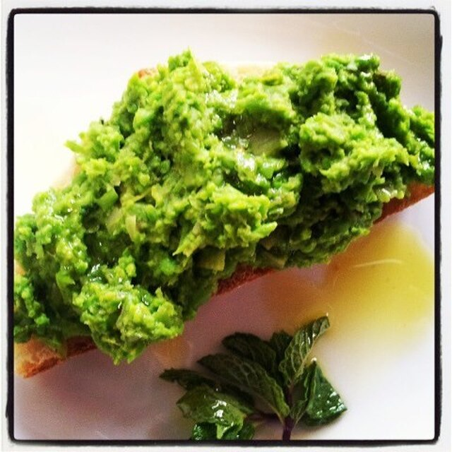 mashed english pea spread on garlic rubbed bruschetta with roasted salmon
