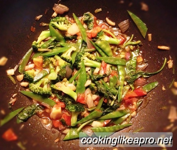 Cooking Snow Peas with Tomato and Broccoli